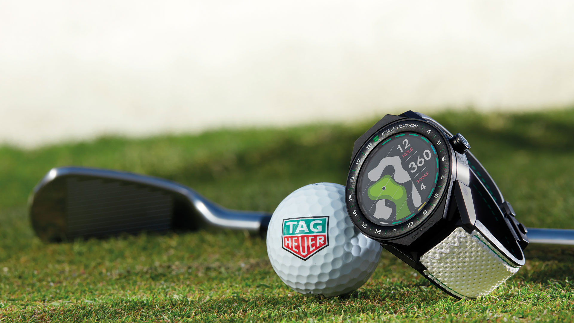 TAG Heuer Watch golf ball and club on green