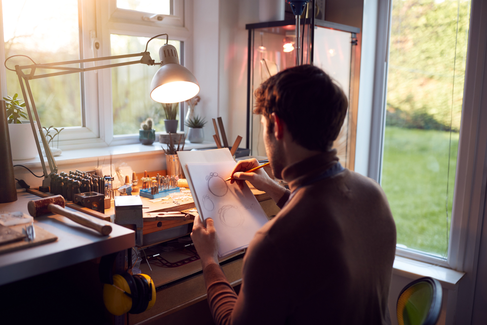 Male,Jeweller,Sketching,Out,Design,For,Ring,In,Studio